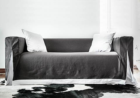 Long skirted Klippan sofa cover with unique pleats and contrast skirting by Comfort Works