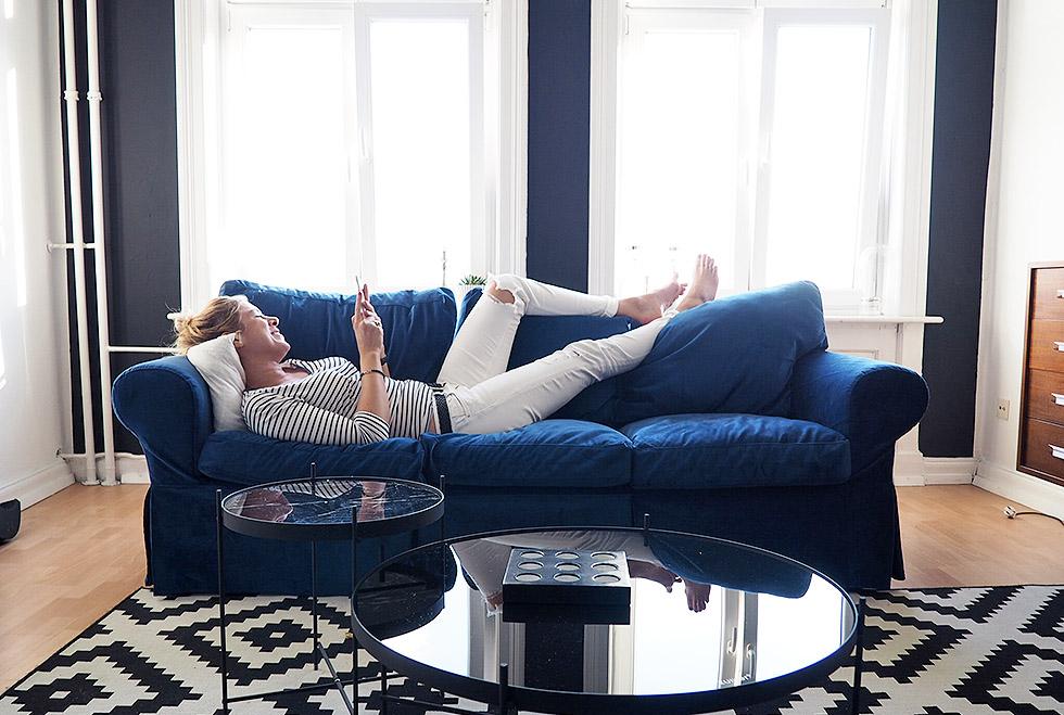 Jenny enjoying her gorgeous Rouge Indigo custom sofa cover for the IKEA Ektorp 3 seater sofa