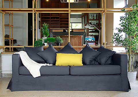 Long-skirted IKEA Karlstad custom sofa cover / slipcover in Gaia Charcoal with pleats, by Comfort Works