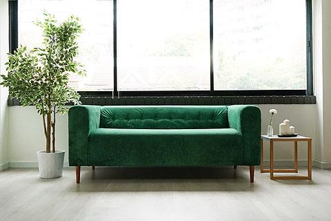 Sofá Klippan de IKEA con Funda Rouge Emerald personalizada con Botones Tufting